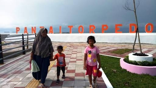 Pantai Torpedo Wisata Baru Yang Menjanjikan Di Tiku Amcnews Co Id